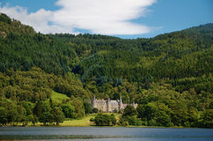 Tigh Mor Castle, Loch Achray. Tigh Mor Castle on the shores of Loch Achray in Scotland Royalty Free Stock Images