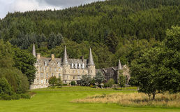 Tigh Mor Castle Trossachs Scotland. Beautiful Tigh Mor nestled in  a green forest background in the Trossachs, Scotland Stock Photos