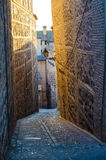 Tight Alley in Toledo, Spain. Toledo is known for its tight alleys and paths in the medieval walled historic city center royalty free stock image