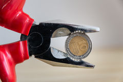Tight budget. Concept shown using pliers Royalty Free Stock Image