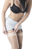 Tight Crop of a Raunchy Glamorous Classic Young Model Playing With Stockings Stock Photo