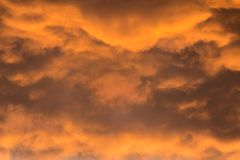 Orange dramatic clouds at sunset stock photos