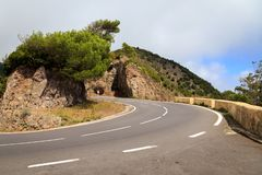 Tight curve in mountains. Dangerous hairpin curve on mountain slope in the Rural de Anaga Park on Tenerife island stock images