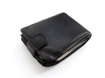 Tight-filled leather wallet. Tight-filled with money black leather wallet Stock Photo