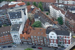 Tight fit. Small historic buldings surrounded by newer buildings in Hamburg, Germany stock images