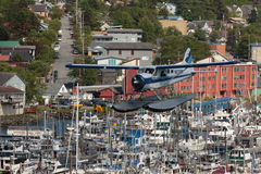 Tight Fit Landing. Ketchikan, AK, USA - May 24, 2016: Seaplane threads the needle for a congested landing stock images
