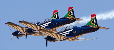 Tight formation of 3 Silver Falcons Royalty Free Stock Image