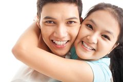Tight hug. Faces of two young people embracing tight Stock Image