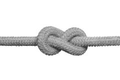 Tight knot on the rope. Tight knot on the rope (concept of unsolved problem) isolated on the white background Stock Image
