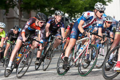 Tight Pack Of Cyclists Lean Into Turn In Amateur Race. Athens, GA, USA - April 25, 2015: A tightly packed group of male cyclists lean into a turn while racing in stock photo