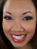 Tight portrait of smiling black woman with braces Stock Image
