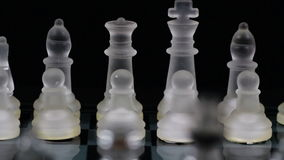 Tight Shot Of Glass Chess Pieces Set Up On Far Side Of Board stock footage