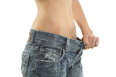 Tight shot of a thin woman's waist. A close up image of a thin womin in jeans Stock Photos