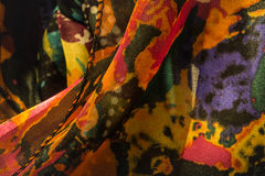 Tight shot of women`s colorful scarves. Several colorful women`s scarves hanging in a closet royalty free stock photo