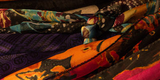 Tight shot of women`s colorful scarves. Several colorful women`s scarves hanging in a closet royalty free stock photography