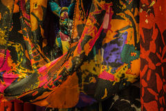 Tight shot of women`s colorful scarves. Several colorful women`s scarves hanging in a closet royalty free stock image