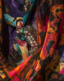 Tight shot of women`s colorful scarves. Several colorful women`s scarves hanging in a closet stock photography