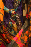 Tight shot of women`s colorful scarves. Several colorful women`s scarves hanging in a closet royalty free stock photos