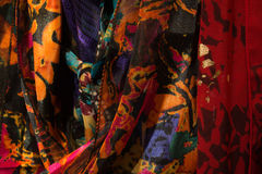 Tight shot of women`s colorful scarves. Several colorful women`s scarves hanging in a closet stock photo