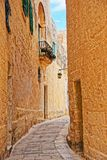 Tight Street with lantern at ancient city in Mdina Royalty Free Stock Photography