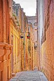 Tight Street with lantern in ancient city of Mdina Stock Images