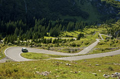 Tight turn on a mountain road Stock Photography