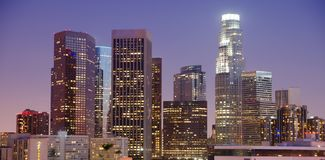 Tight View Highest Buildings Downtown Los Angeles California. Bright reflections at sunset on the buildings and architecture of Los Angeles California royalty free stock photo