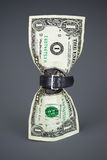Tighten belt on dollar concept reduced budget. Tighten belt on dollar concept Royalty Free Stock Photography