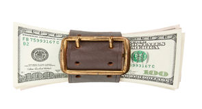 Tighten belt and stack of dollars. Isolated on white Stock Image