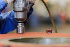 Tighten bolt with pneumatic torque wrench. Technician use pneumatic torque wrench for tighten bolt Stock Photos