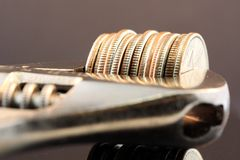 Tighten Budget & Savings. Symbol of budget shrink and tighten your budget. This photo conveys financial management concepts such as, inflation, budget reduction Royalty Free Stock Photo