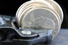 Tighten Budget & Savings. Symbol of budget shrink and tighten your budget. This photo conveys financial management concepts such as, inflation, budget reduction Stock Photography