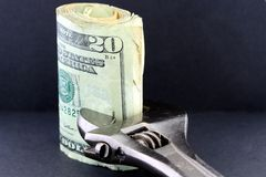 Tighten Budget & Savings. Symbol of budget shrink and tighten your budget. This photo conveys financial management concepts such as, inflation, budget reduction Royalty Free Stock Images
