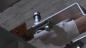 Tighten the screws stock footage