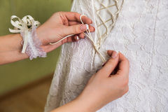 Tighten wedding dress Stock Photography