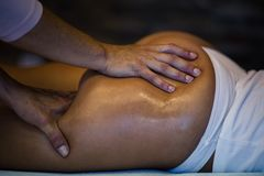 Tighten your body. The masseur makes Anti-cellulite massage on the buttock and thighs of the patient. Close up. copy space royalty free stock photography
