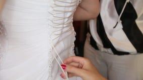 Tightened bride corset. On white wedding elegant dress stock video footage