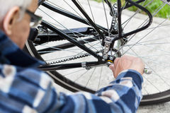 Tightening the bolts on a bicycle wheel Stock Image