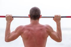 Tightening on horizontal bar for strong arms Stock Images