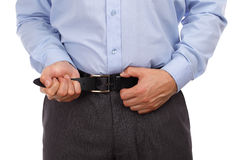 Tightening ones belt. Businessman tightening his belt concept for recession or economic depression royalty free stock images