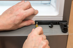 Tightening the screw with a screwdriver closeup Stock Photo
