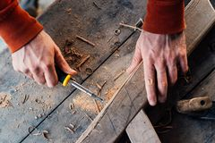 Tightening with a screwdriver in the wooden bar, making furniture royalty free stock images