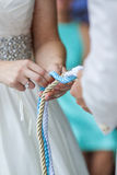 Tighting the knot Stock Images