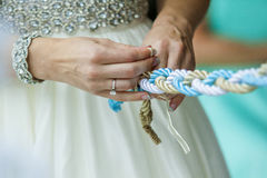 Tighting the knot Royalty Free Stock Images