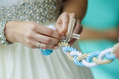 Tighting the knot Royalty Free Stock Photo
