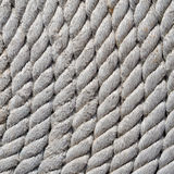 Tightly coiled fishing rope close up. Stock Images