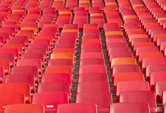 Tightly packed stadium chairs Stock Images