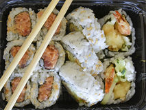 Tightly packed sushi rolls on platter Stock Photo