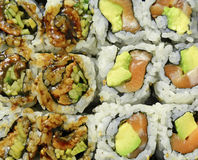 Tightly packed sushi rolls on platter Stock Images