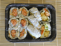 Tightly packed sushi rolls on platter Royalty Free Stock Images